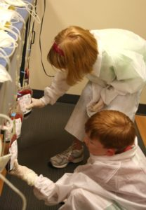 Examining the bags to be sure no plasma or white cells got in!